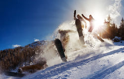 Snowboard jump power. Powerful image of a snowboarder jumping over a kicker in the backcountry powder Stock Photos
