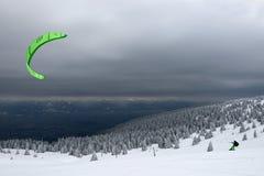 Snowboard kiting Stock Photo