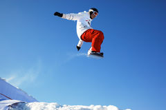 Snowboard man extreme fly Stock Photography