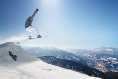 Snowboard in montagne Fotografie Stock