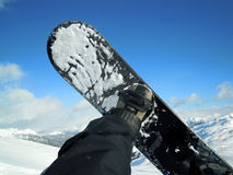 Snowboard and mountain. With blue sky royalty free stock photo