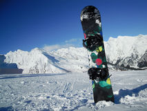 Snowboard and mountain. With blue sky royalty free stock photography