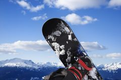 Snowboard and mountain. Snowboard and mountain in Whistler, British Columbia, Canada stock photography