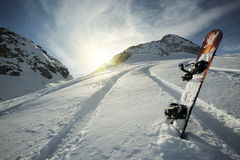 Snowboard in mountains Stock Photography