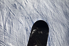 Snowboard over off-piste slope with track from ski and snowboard Stock Photography