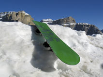 Snowboard resting in Dolomities Stock Photography