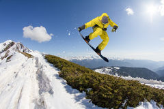 Snowboard rider jumping on mountains. Extreme snowboard freeride sport. Stock Image