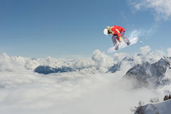 Snowboard rider jumping on mountains. Extreme snowboard freeride sport. Royalty Free Stock Photo