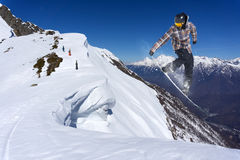 Snowboard rider jumping on mountains. Extreme snowboard freeride sport. Royalty Free Stock Images