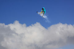 Snowboard rider jumping on mountains. Extreme snowboard freeride sport. Stock Photos