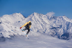 Snowboard rider jumping on mountains. Extreme snowboard freeride sport. Royalty Free Stock Photos