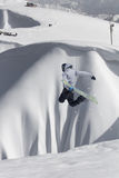 Snowboard rider jumping on mountains. Extreme snowboard freeride sport. Stock Images