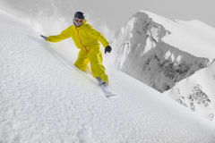Snowboard rider moving down in snow powder Stock Photos
