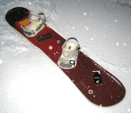 Snowboard Rossignol Nomad 2 Wide 160cm in the Snow Royalty Free Stock Photos