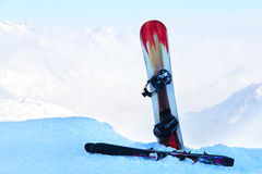 Snowboard and ski in mountains Stock Photography