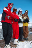 Snowboard and ski team. On the top of the slope crossing hands and feets Royalty Free Stock Photos