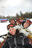 Snowboard and ski team. Small group of  snowboarders laying on slope, smiling Royalty Free Stock Photography