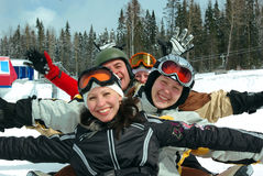 Snowboard and ski team. Small group of  snowboarders laying on slope, smiling Stock Photography