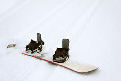 Snowboard on Ski Track Stock Photography