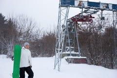 Snowboard skier next to ski lift Royalty Free Stock Photos