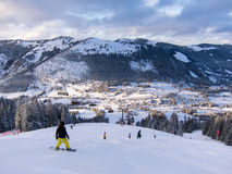 Snowboard Slope. Unidentifiable Snowboarders on the slopes of mount Iseler, facing Oberjoch mountain village Stock Image