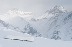 Snowboard at slope in the Alpine mountains. Morning Stock Image