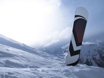 Snowboard in snow Stock Images