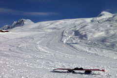 Snowboard in snow on ski slope at sun windy evening Stock Image