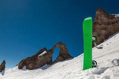 Snowboard standing on background of mountains Royalty Free Stock Photography