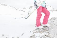 Snowboard, stivali e primo piano dei pantaloni Fotografia Stock Libera da Diritti