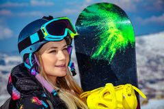 Snowboard trainer. Portrait of a cute blond snowboard trainer in the snowy mountains, extreme winter sport, competition between snowboarders, active wintertime royalty free stock photos