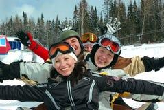 Snowboard- und Skiteam Stockfotografie