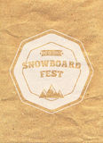 Snowboard vintage circled logotype on kraft paper background.  Stock Image