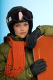 Snowboard woman in orange and green outfit Royalty Free Stock Image