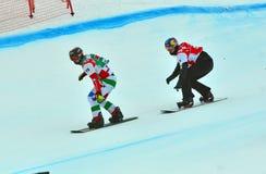 Snowboard World Cup. VEYSONNAZ, SWITZERLAND - MARCH 14:  Omar VISINTIN (ITA) leads Alex PULLIN (AUS) in the finals of the Snowboard Cross World Cup: March 14 Stock Image