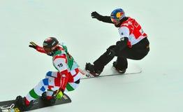 Snowboard World Cup. VEYSONNAZ, SWITZERLAND - MARCH 14:  VISINTIN (ITA) leads PULLIN (AUS) in the finals of the Snowboard Cross World Cup: March 14, 2015 in Stock Photography
