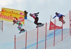 Snowboard World Cup. VEYSONNAZ, SWITZERLAND - MARCH 14: VISINTIN (ITA) leads PULLIN (AUS) over the jump in the finals of the Snowboard Cross World Cup: March 14 Stock Photo