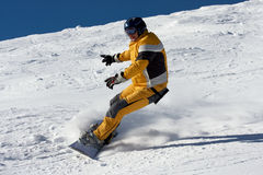 Snowboard in yellow suite Royalty Free Stock Photo