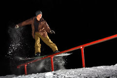Snowboard. Young snowboarder grinding the Rail royalty free stock image