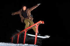 Snowboard. Young snowboarder grinding the Rail stock photos