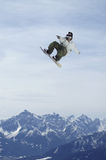 Snowboardcruise. A snowboarder cruises through the air in the funpark above Innsbruck Stock Images