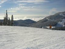 Snowboarder über den Wolken Stockfotografie