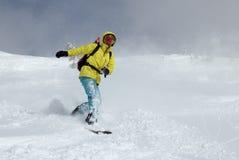 Snowboarder στο λόφο Στοκ Φωτογραφία