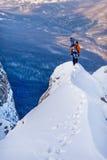 Snowboarder в горах Стоковые Фото