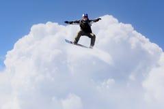 Snowboarder делая скачку стоковое фото rf