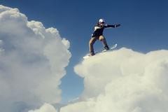 Snowboarder делая скачку стоковое фото