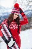 Snowboarder женщины на зимний день наклонов морозный Красивейшее gir Стоковое Изображение