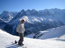 Snowboarder на солнечном сезоне зимы Стоковые Изображения