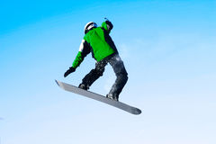 Snowboarder. In jump over blue clear sky Stock Photos