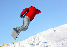Snowboarder. In jump over blue clear sky Royalty Free Stock Images